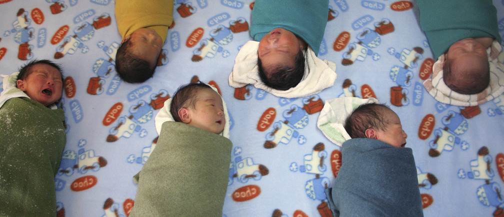 Newborn babies wait to be massaged inside a children's hospital in Xining, in northwestern China's Qinghai province, November 13, 2006. A population expert has called on China's legislature to make it a criminal offence to identify the sex of an embryo for non-medical purposes and also to outlaw abortions that are not medically justified, Xinhua News Agency reported. REUTERS/Simon Zo (CHINA) - GM1DTXWQEXAA