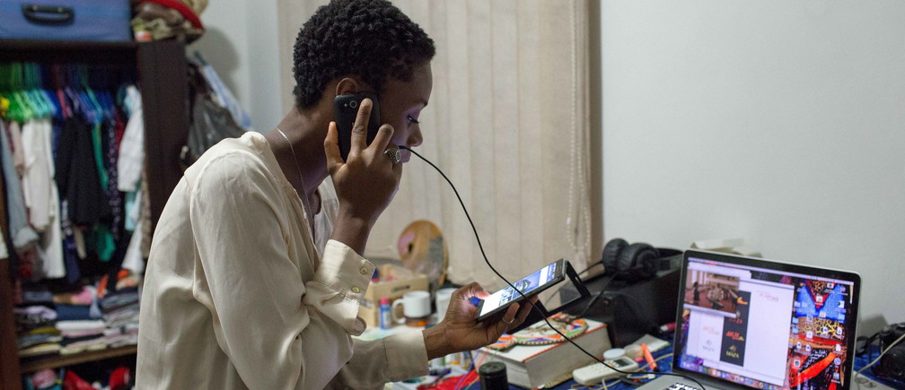 Illustrator Sena Ahadji speaks to a client on the phone from her house in Accra, Ghana, July 24, 2015.