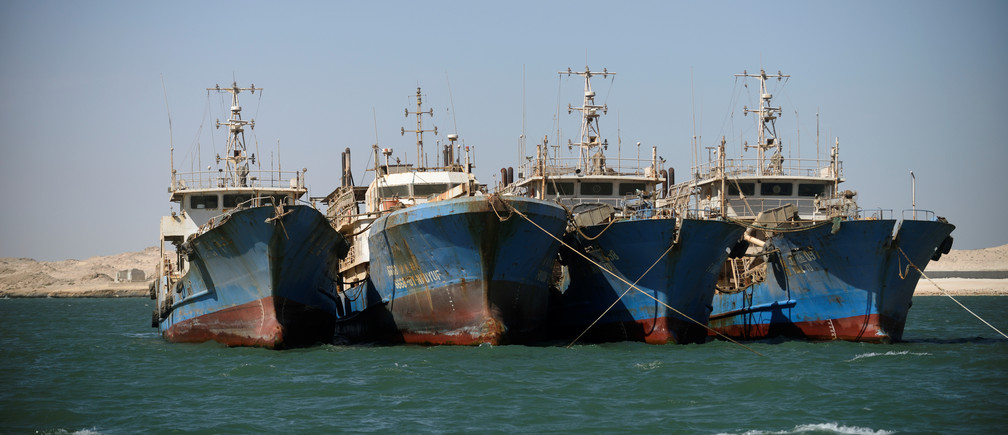 Chinese fishing vessels are seen moored off the coast of Nouadhibou, Mauritania, April 14, 2018. Picture taken April 14, 2018. To match Special Report OCEANS-TIDE/SARDINELLA    REUTERS/Sylvain Cherkaoui - RC1313283590