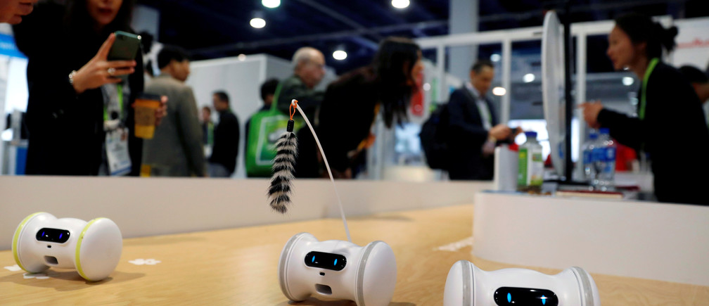 Pet fitness robots, which move automatically or are controlled with a smartphone, are displayed at the Varlam booth during the 2019 CES in Las Vegas, Nevada, U.S. January 9, 2019. REUTERS/Steve Marcus     TPX IMAGES OF THE DAY - RC116DBA4A40