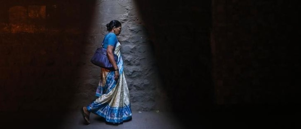 A woman walks through a subway under railways tracks in Mumbai January 7, 2014. REUTERS/Danish Siddiqui (INDIA - Tags: SOCIETY TPX IMAGES OF THE DAY)