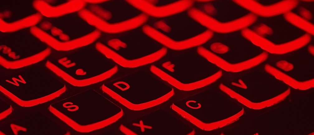 Cyberattacks: a red-lit keyboard.