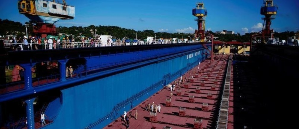 Docks' workers walk inside a newly acquired floating dock produced in China to repair Panamax-type ships in Havana, Cuba, October 30, 2019. REUTERS/Alexandre Meneghini - RC1EA41DBED0