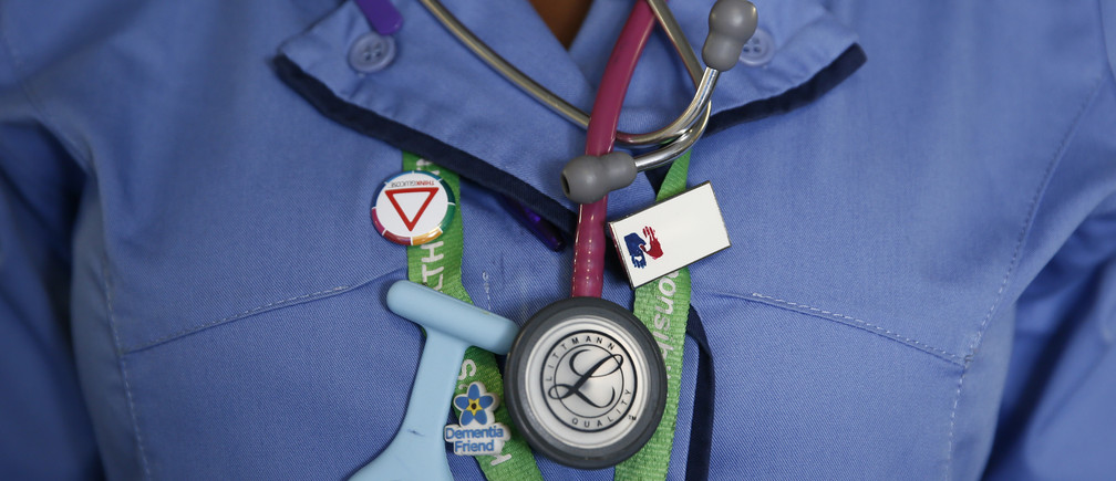 A nurse wears a watch and stethoscope at St Thomas' Hospital in central London January 28, 2015. Dearly-loved and overburdened, Britain's national health system has become the top issue for voters ahead of May's election, after winter brought headlines of ambulances queueing outside hospitals and patients languishing on trolleys for hours.The National Health Service (NHS) delivers care for free to the whole population from cradle to grave and accounts for a third of government spending on public services. Photograph taken January 28, 2015. REUTERS/Stefan Wermuth (BRITAIN - Tags: POLITICS HEALTH ELECTIONS) - LM1EB221CXY01