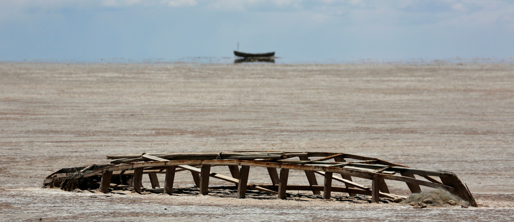 A carcase of a boat is seen on the dried lake Poopo affected by climate change, in the Oruro Department, Bolivia, December 16, 2017. Picture taken December 16, 2017. REUTERS/David Mercado - RC19D4485190