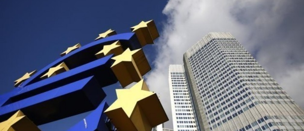 The Euro currency sign is seen next to the European Central Bank (ECB) headquarters in Frankfurt November 6, 2012. The European Central Bank is set to leave interest rates unchanged on Thursday, deferring a cut in borrowing costs that would risk undermining the impact of Mario Draghi's signature policy a year into his ECB presidency. A raft of weak economic data support the case for cutting rates but to do so could stir up debate in Germany about the ECB going soft under Draghi and blunt the impact of his new bond-purchase plan, dubbed Outright Monetary Transactions (OMT).