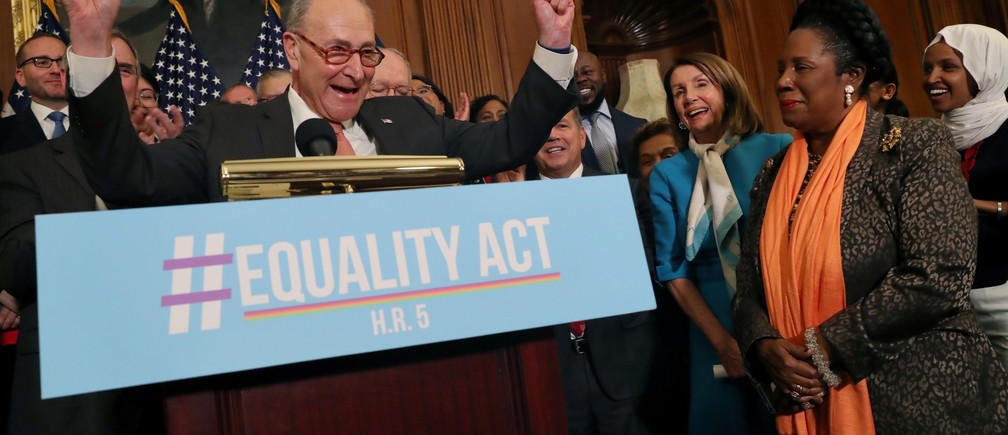 Democratic leaders including U.S. Senate Democratic leader Chuck Schumer, left, and U.S. House of Representatives Speaker Nancy Pelosi and other supporters cheer as they gather to announce the introduction of the Equality Act at the U.S. Capitol building in Washington, U.S., March 13, 2019. REUTERS/Leah Millis - RC1C5BBCE430