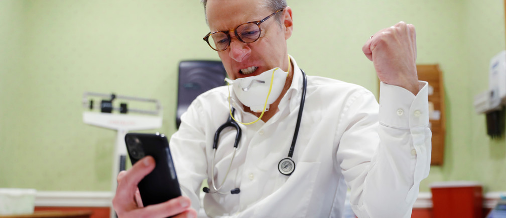 Dr Greg Gulbransen takes part in a telemedicine call with a patient while maintaining visits with both his regular patients and those confirmed to have the coronavirus disease (COVID-19) at his pediatric practice in Oyster Bay, New York, U.S., April 13, 2020.  Picture taken April 13, 2020.