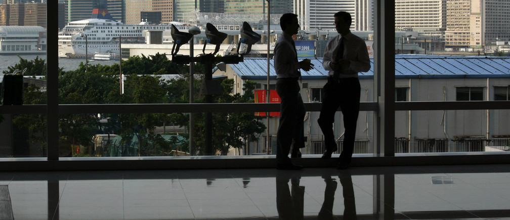 Expatriate business workers chat after office hour inside Two IFC, the territory's highest building at Hong Kong's financial business district July 13, 2009.