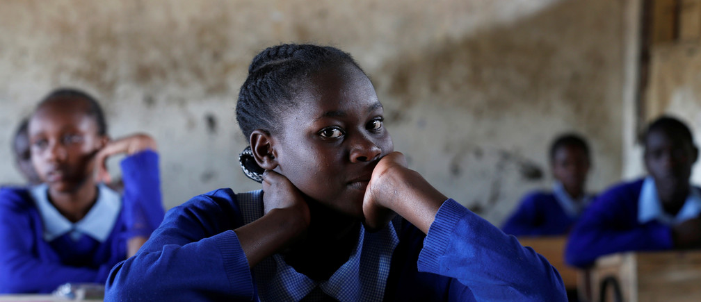 A pupil sits inside a classroom ahead of the primary school final national examinations at Kiboro Primary school along Juja road in Nairobi, Kenya October 31, 2017. REUTERS/Thomas Mukoya