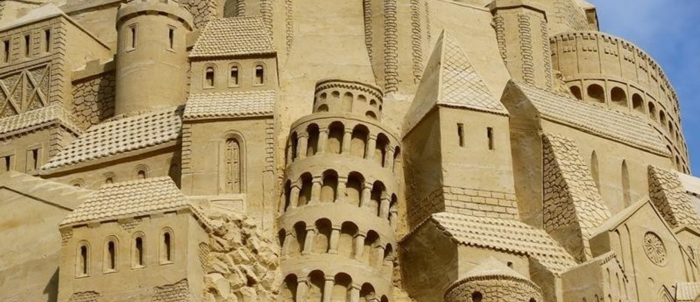"A close-up picture from the world's highest sand castle shows the famous ""Leaning Tower of Pisa"" and the Rome ""Collosseum"" following the official confirmation by a judge of Guinness World Records with the new record heights of 16.68 metres, in Duisburg, Germany, September 1, 2017."