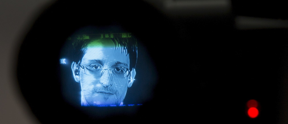 American whistleblower Edward Snowden is seen through a camera viewfinder as he delivers remarks via video link from Moscow to attendees at a discussion regarding an International Treaty on the Right to Privacy, Protection Against Improper Surveillance and Protection of Whistleblowers in Manhattan, New York September 24, 2015. The event, hosted by global advocacy group Avaaz, was held to coincide with the United Nations General Assembly.