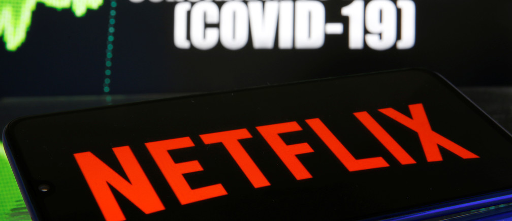 Netflix logo is seen in front of diplayed coronavirus disease (COVID-19) in this illustration taken March 19, 2020.