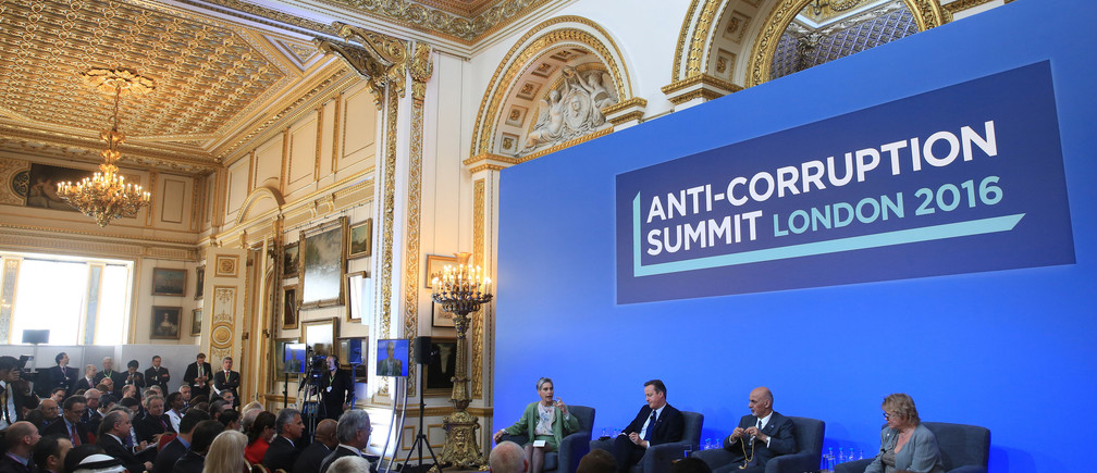 Sarah Chayes from the Carnegie Endownment for International Peace,British Prime Minister Cameron, Afghan President Ghani and French magistrate Eva Jolly share a platform at the international anti-corruption summit, London, Britain