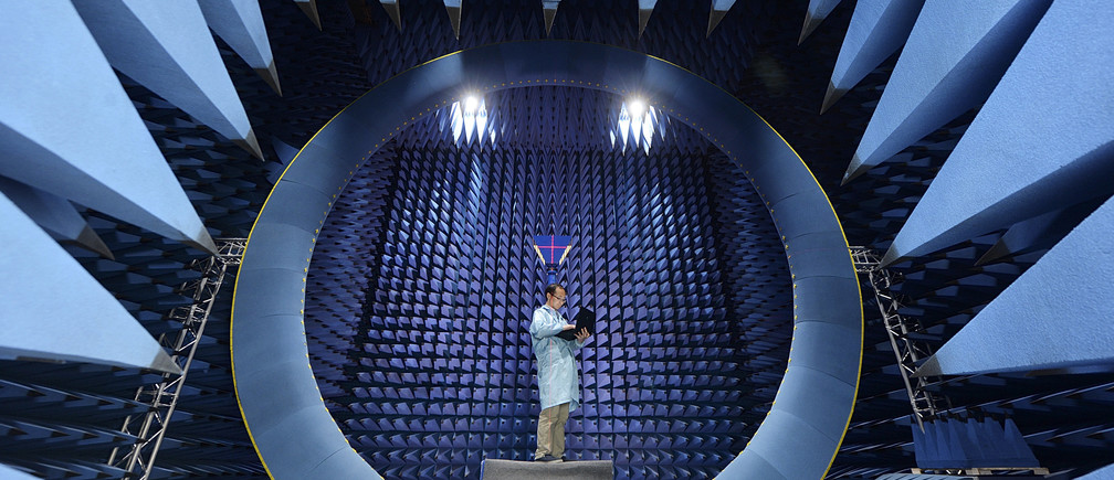 An employee conducts tests at an antenna near field, at a factory of FiberHome Technologies Group, in Wuhan, Hubei province, China, July 27, 2015.