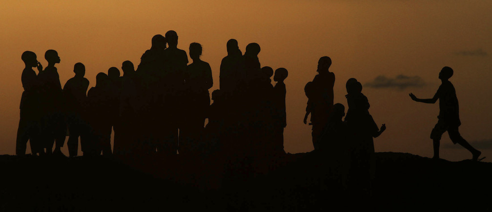 Children play on Dala hill at sunset in the old city district in Nigeria's northern state of Kano September 9, 2010. REUTERS/Akintunde Akinleye (NIGERIA - Tags: SOCIETY CITYSCAPE) - GM1E69A0FFZ01