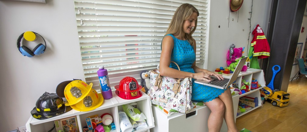 Chief executive of California-based social and educational group for parents Club MomMe Rachel Pitzel works at her home in Playa Vista, California, June 10, 2015.