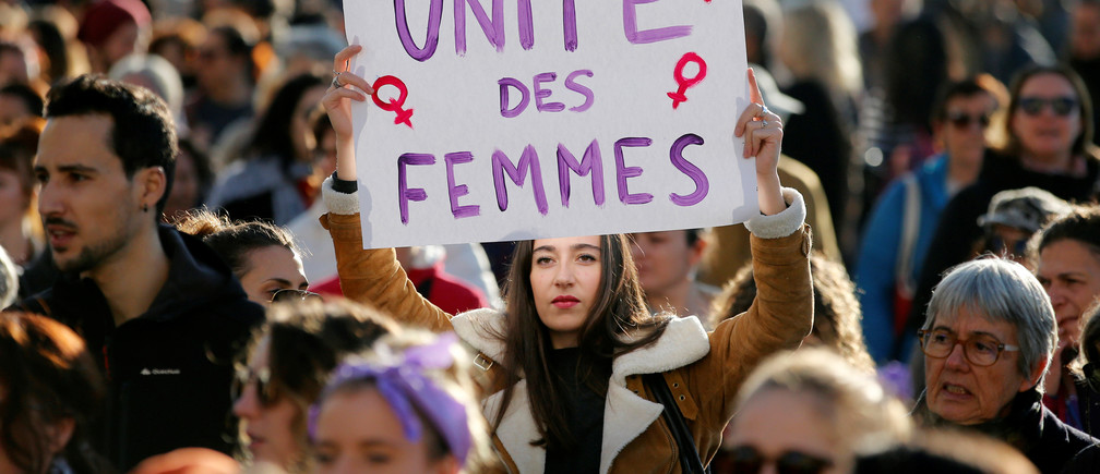 "Demonstrators attend a rally against the gender-based and sexual violence against women in Marseille, France, November 24, 2018. The placard reads ""Women's unity"". REUTERS/Jean-Paul Pelissier - RC1319355010"