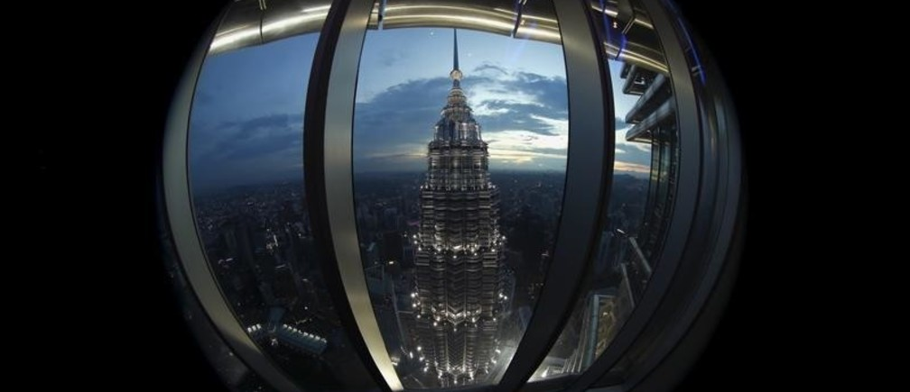 A view of one of the Petronas Towers is seen from windows of its twin building during the Association of Southeast Asian Nations (ASEAN) summit in Kuala Lumpur, Malaysia, November 22, 2015. Picture taken with a fisheye lens. REUTERS/Jorge Silva - RTX1V9UZ
