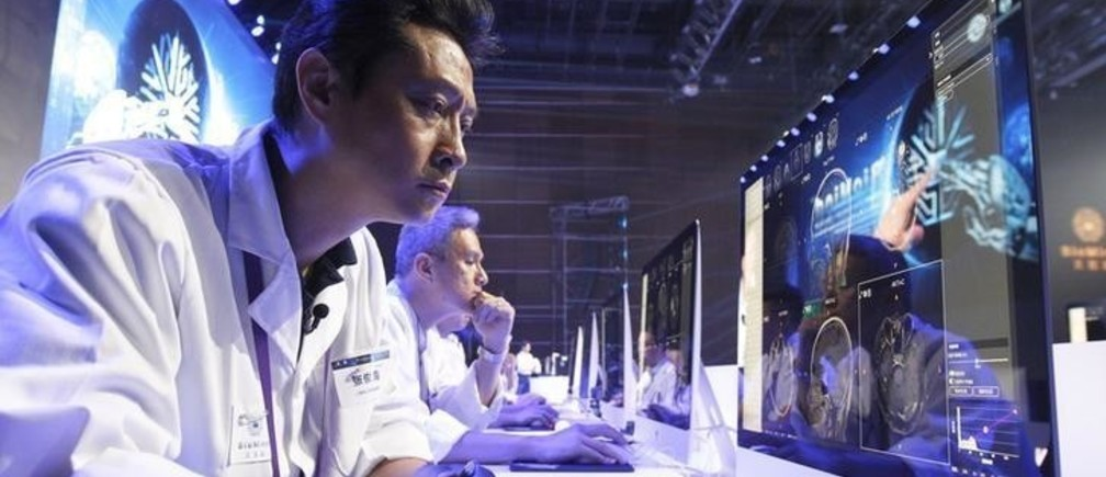 A doctor reads medical images on a screen during a diagnostic competition between an AI machine and human experts at the China National Convention Center in Beijing, China, June 30, 2018. Picture taken June 30.  China Daily/via REUTERS