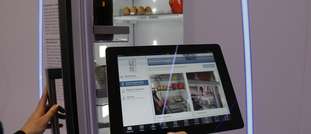 An app shows the inside of a fridge, that has cameras and a link to a network onboard, during the opening day of the IFA consumer electronics fair in Berlin September 6, 2013.