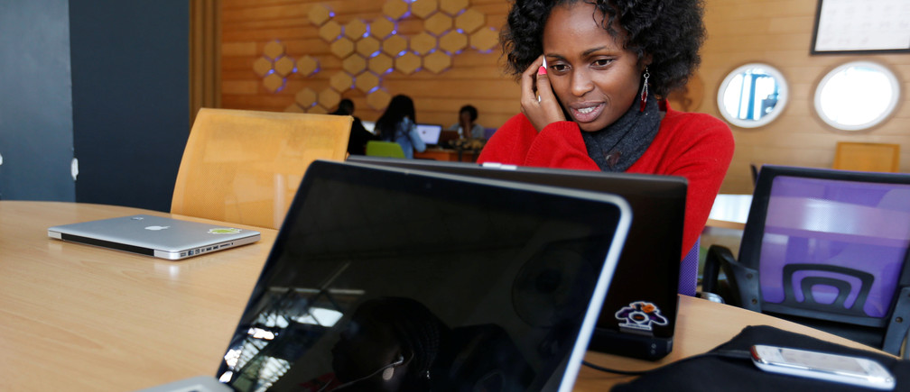 Entrepreneurs work on their projects at Nailab, a Kenyan firm that supports technology startups, behind the latest initiative, which targets entrepreneurs for their ideas on providing sex education through technology and social media in Nairobi, Kenya, July 4, 2016. REUTERS/Thomas Mukoya - D1BETNPFICAA
