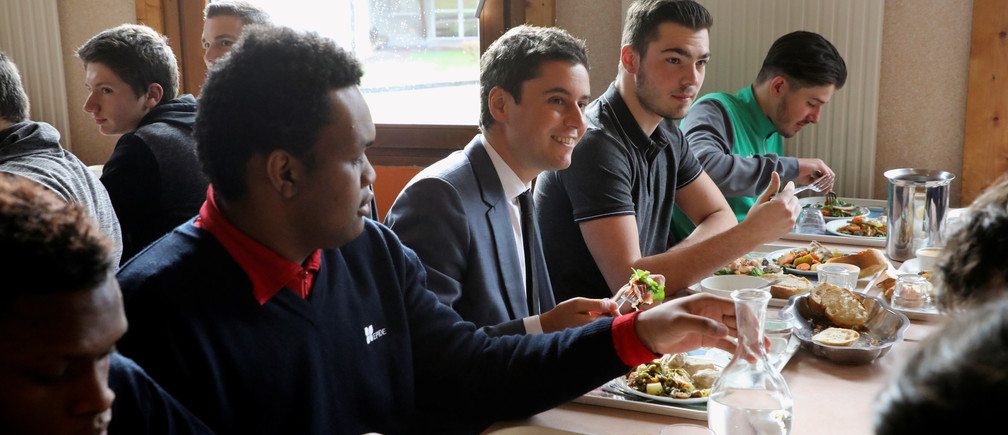 French Junior Minister attached to the Education Minister Gabriel Attal has lunch with students in the canteen of an EPIDE (Etablissement pour l'insertion dans l'emploi) school ahead of a national debate session, in Etang-sur-Arroux, France February 7, 2019. Ludovic Marin/Pool via REUTERS - RC1A5F387030