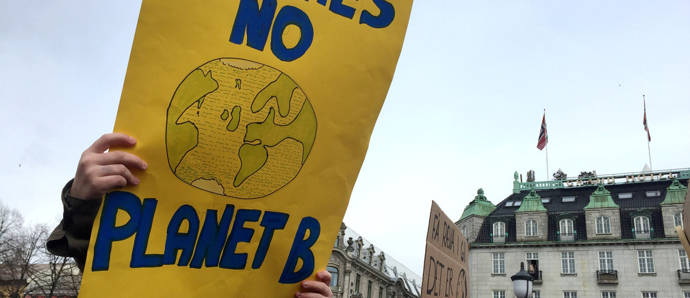 A student holds a placard during a protest against climate change in front of the Parliament building  in Oslo, Norway March 22, 2019. REUTERS/Nerijus Adomaitis - RC1D1973C0C0