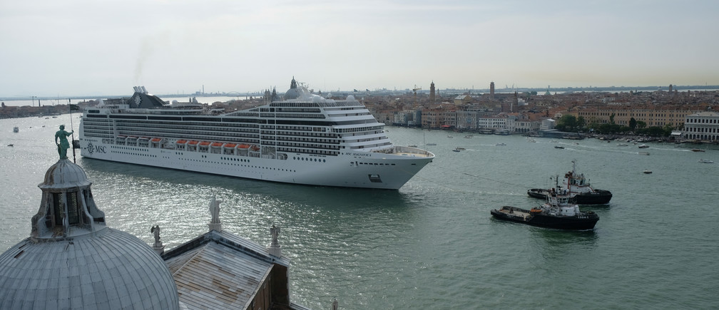 A cruise ship passes in the Giudecca Canal in Venice.