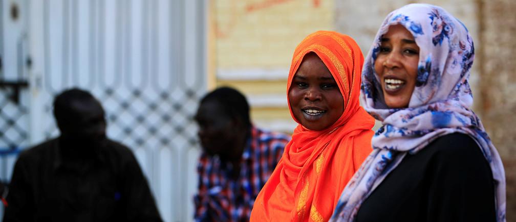 Sudanese women stand in a street in Khartoum, Sudan, April 30, 2019.