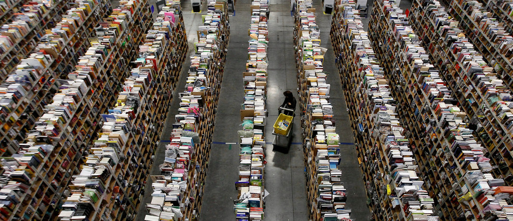 "A worker gathers items for delivery from the warehouse floor at Amazon's distribution center in Phoenix, Arizona November 22, 2013.  REUTERS/Ralph D. Freso/File Photo  GLOBAL BUSINESS WEEK AHEAD PACKAGE - SEARCH ""BUSINESS WEEK AHEAD JULY 25"" FOR ALL IMAGES - S1BETRNKTMAA"