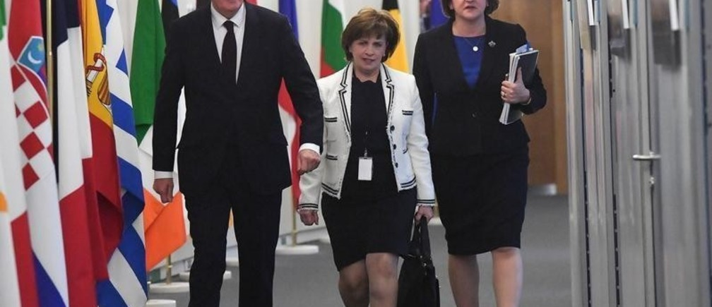 European Union's chief Brexit negotiator Michel Barnier walks with Northern Ireland's Democratic Unionist Party (DUP) leader Arlene Foster and DUP member Diane Dodds prior to a meeting at the EU Commission headquarters in Brussels, Belgium October 9, 2018.