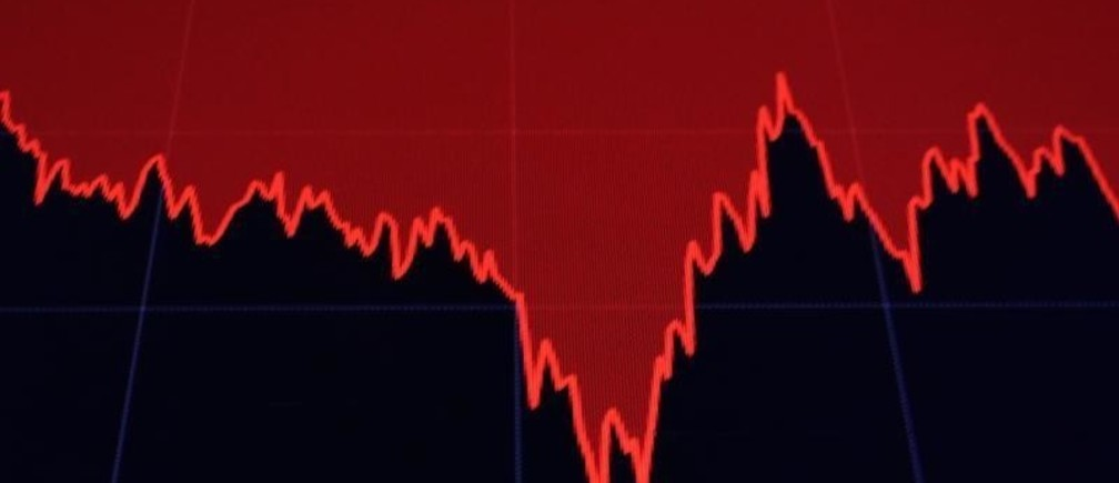 A screen displays a chart of the Dow Jones Industrial Average after the close of trading on the floor of the New York Stock Exchange
