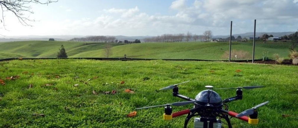 """An Aeronavics drone sits in a paddock near the town of Raglan, New Zealand, July 6, 2015. Deep in New Zealand's dairying heartland, drone maker Aeronavics tests aircraft designed to corner the fast-growing emerging market for unmanned aerial vehicles in the film and television business. The developer of drones used in the production of """"Dr. Who"""" and the """"Twilight"""" films is one of a stable of New Zealand firms that are using the country's reputation for innovation in the film industry to stake out claims to what is expected to be a drone boom in Hollywood. The relaxation of U.S. rules for commercial drones late last year has sparked a race to develop specialised flying camera platforms for studios to hire for a fraction of the cost of jibs, cranes or even helicopters to capture swooping aerial shots. Picture taken July 6, 2015.    REUTERS/Naomi Tajitsu - GF10000164426"""