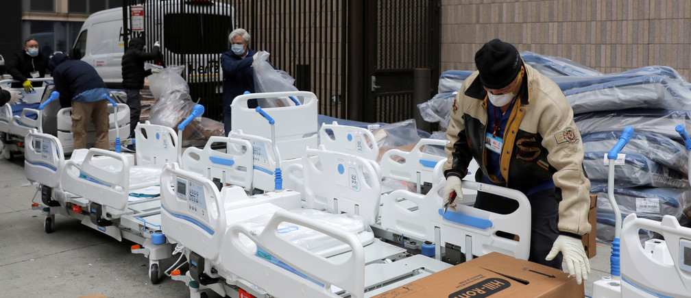 Workers prepare part of a delivery of 64 hospital beds from Hillrom to The Mount Sinai Hospital during the outbreak of the coronavirus disease (COVID-19) in Manhattan, New York City, U.S., March 31, 2020