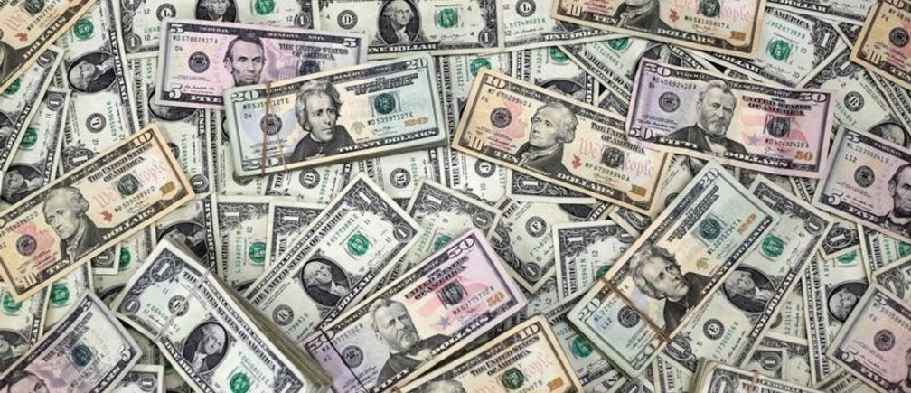 U.S. Dollar banknotes are seen in this photo illustration taken February 12, 2018.