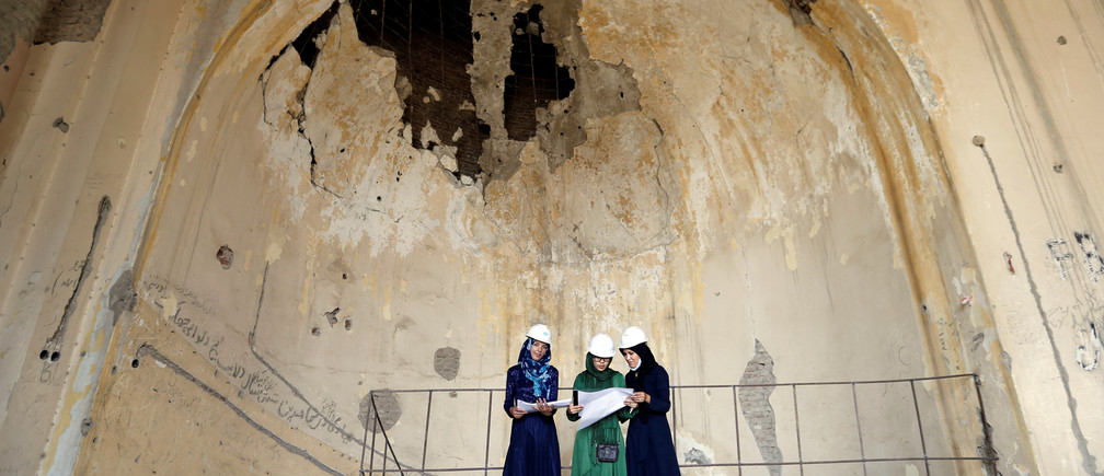 Afghan female engineers work on a map of the ruined Darul Aman palace in Kabul, Afghanistan October 2, 2016. Picture taken October 2, 2016. REUTERS/Mohammad Ismail  - RTSR5AH