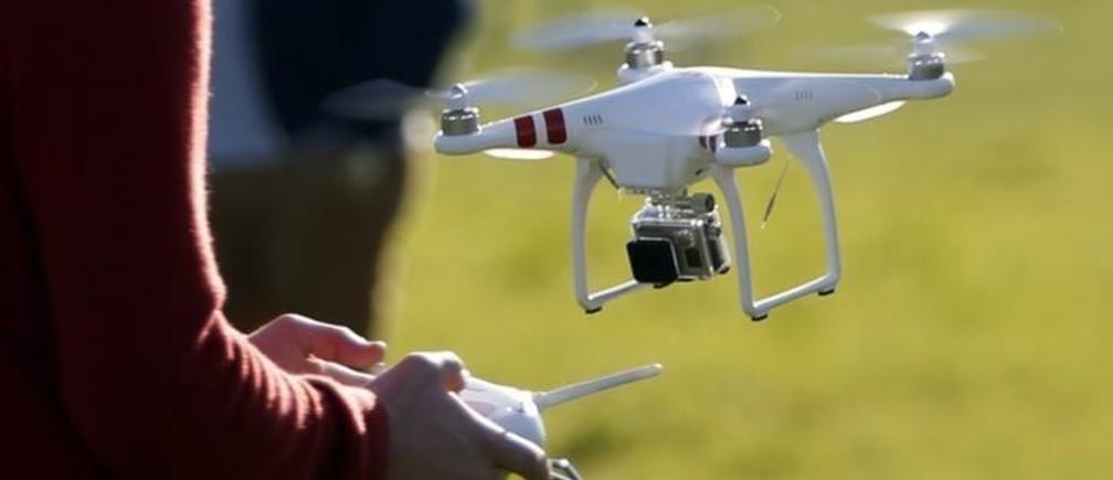 A pilot flies a phantom drone.