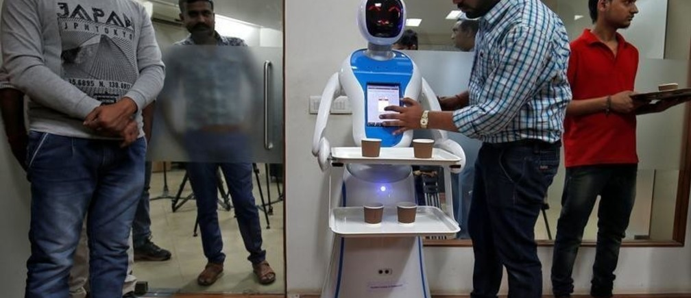 An engineer programs a robot waiter during a media preview at the Gujarat Science City in Ahmedabad, India, November 20, 2018. REUTERS/Amit Dave - RC1D67BD06B0