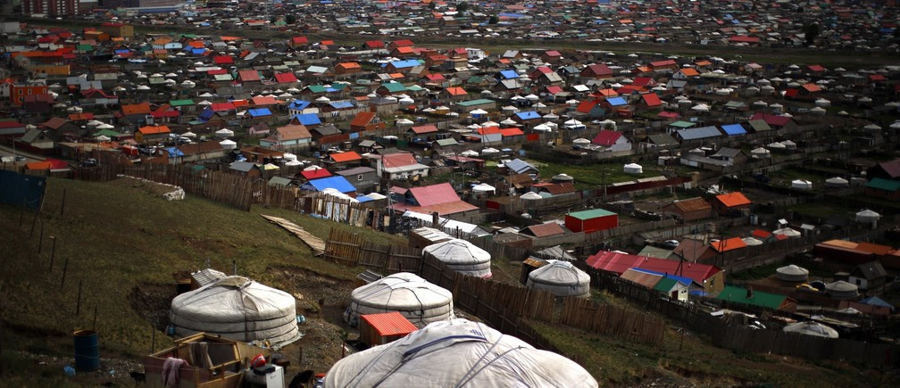 Gers, traditional Mongolian tents, are seen on a hill in an area known as a ger district in Ulan Bator June 28, 2013.