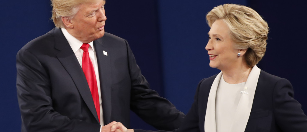 Republican U.S. presidential nominee Donald Trump and Democratic U.S. presidential nominee Hillary Clinton shake hands at the conclusion of their presidential town hall debate at Washington University in St. Louis, Missouri, U.S., October 9, 2016.