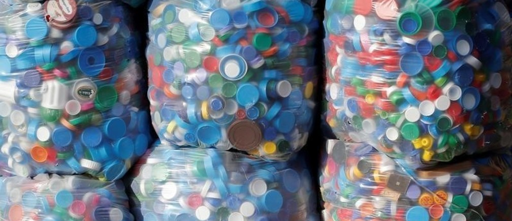 Bags filled with caps are pictured at the Association Bouchon d'Amour which collects and recycles plastic caps in Martignas-Sur-Jalles near Bordeaux, France, November 23, 2018. REUTERS/Regis Duvignau - RC17D4709770