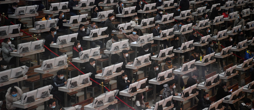 Traders wearing face masks are seen on the trading floor at a flower auction trading centre following an outbreak of the novel coronavirus in the country, in Kunming, Yunnan province, China February 10, 2020.