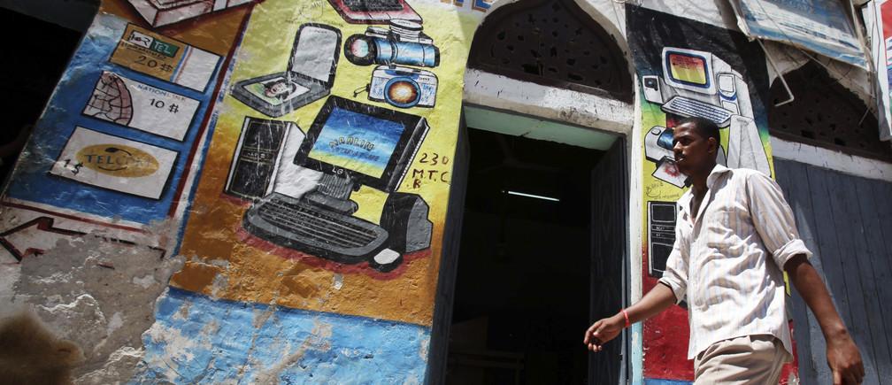 A man walks past an Internet cafe in Hamarweyne district of Somalia's capital Mogadishu, May 16, 2012.