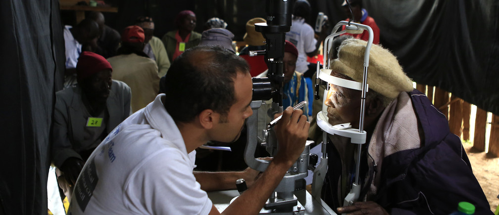 Andrew Bastawrous, an eye specialist, examines a patient at a temporary clinic by International Centre for Eye Health at Olenguruone in the Mau Summit 350km (217 miles) west of Kenya's capital Nairobi, October 29, 2013.