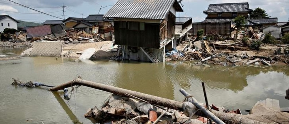 Submerged and destroyed houses are seen in a flooded area in Mabi town in Kurashiki, Okayama Prefecture, Japan, July 10, 2018. REUTERS/Issei Kato