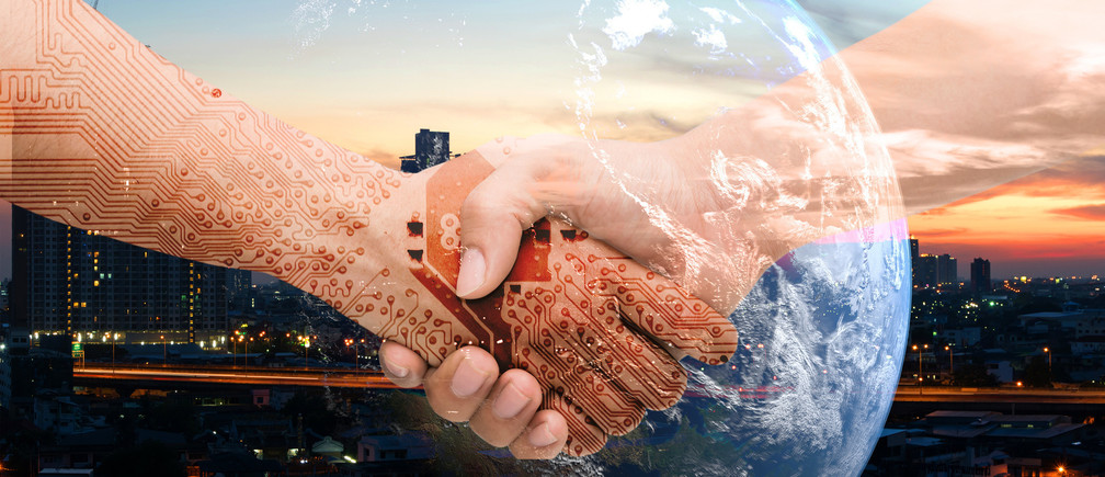 Industry 4.0 internet of things and digital disruption concept. Double exposure of Shaking hands of male people and robot circuit electronic hand with construction building and earth furnished by NASA
