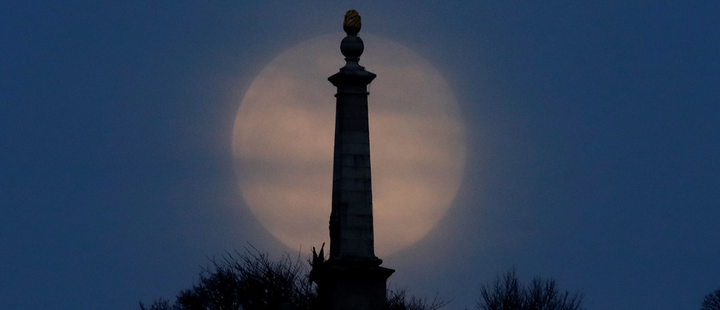 The Pink Supermoon rises over Coombe Hill in the Chilterns in an astronomical event that occurs when the moon is closest to the Earth in its orbit, making it appear much larger and brighter than usual, near Dunsmore, Britain, April 7, 2020. REUTERS/Matthew Childs - RC2VZF9PZZ71