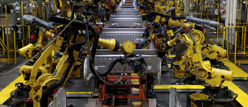 Robot arms work on the boxes of 2018 F150 pick-up trucks at Ford's Dearborn Truck Plant during the 100-year celebration of the Ford River Rouge Complex in Dearborn, Michigan U.S. September 27, 2018.  REUTERS/Rebecca Cook - RC1D371BCDA0