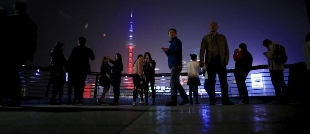 Shanghai's landmark building Oriental Pearl TV Tower is lit up in blue, white and red, the colors of the French flag, following the Paris attacks, in Shanghai, China, November 14, 2015.